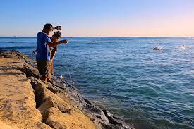 photo essay celebrating the end of summer scenes from hawaii  fishing waikiki beach honolulu hawaii
