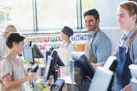 Portrait Smiling Confident Young Male Cashier Working At Grocery Store D1007_12_108