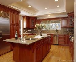 image of cherry kitchen cabinets with granite countertops