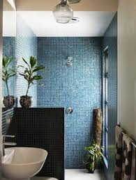 Blue square mosaic tile walls_The home of Nancybird designer Emily Wright  and partner Robert Dabal. Via Valk Chuah Design Files