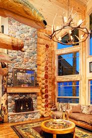 photo of stone fireplace and living room inside a log home