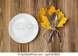 dinner table background. Thanksgiving Dinner Plate With Fork, Knife And Autumn Leaves On Rustic Wooden Table Background. Top Stock Photo Background B