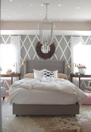 geometric patterns and pastels play nicely in this lush grey bedroom