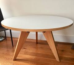 this practical gueridon dining table by jean prouve is a 2010 edition manufactured by vitra