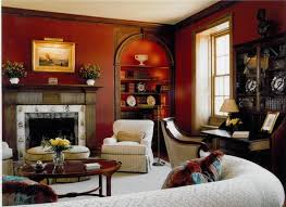 red living room walls add grandeur to a well stocked book collection