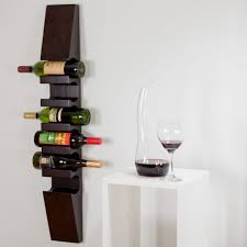 contempo dark wook wall wine rack on the white wall painting along with minimalist white wooden table