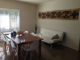 my dining room ikea stornas extendable table and replica eames chairs in white kuba cloth on the wall from africa in love with the white shutters