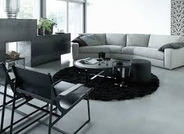 a black area rug can tie together a gray décor