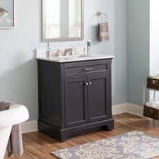 bathroom fixture. bathroom featuring a dark brown vanity with white countertop and mirror on the wall. fixture