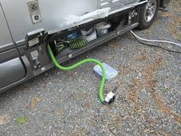 meryl and me hit the road living in the roadtrek dumping the you pull the hose out of its compartment nozzle first it has worked best when the entire hose is removed from the compartment until it reaches its full