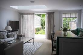heavy voile curtains with laminated roller blind in matching voile