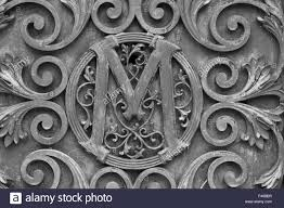 fancy letter m fancy letter m found in cemetery stock photo royalty free image