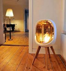 indoor stove concept this beautiful fireplace by is as lovely it functional features brass reflectors heat do fireplace reflectors