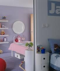Sliding door separating boy's and girl's bedrooms