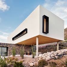 desert home designs. volcanic stone contrasts with white stucco at texas desert home by hazelbaker rush designs t