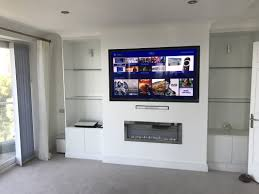 a custom installation in conjunction with builders furniture builders to install a 65 led sony tv sky q receiver sony blu ray player and bose 5 1 home