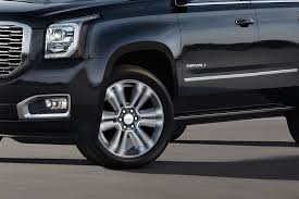 2018 gmc yukon xl. modren yukon closeup image of the left exterior on a black 2018 gmc yukon xl denali full on gmc yukon xl