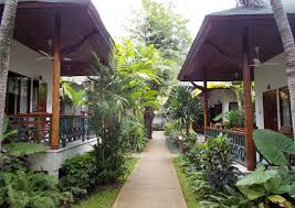 bungalow cer amongst gardens at the resort
