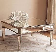 mirrored glass coffee table its antiqued mirror top is as striking as the round shape drawer