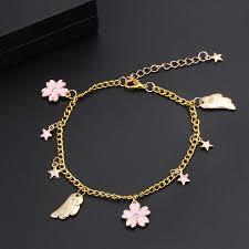 2019 sailor moon sakura bracelet moon star heart pendant bracelets for women cute flower cardcaptor magic wand cuff wings accessories from cukojew