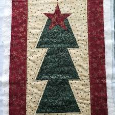 christmas & The first table runner was made with Moda fabrics, machine pieced and  quilted with metallic thread. This is the third time I have used this easy  design. Adamdwight.com