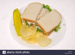 Tuna Mayo Sandwich On White Bread With Potato Chips And Pickle On