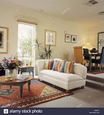 Striped Rug In Living Room White Sofa With Patterned Cushions In Yellow Spanish Living Room