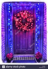 Wreath With Blue Lights Lighted Christmas Wreath On Wood Door With Blue Light Trim