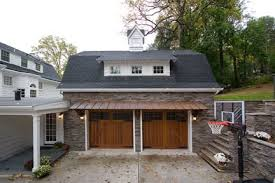 garage with office above. this garage with roomprivate office above also has a hydrolic car lift to o