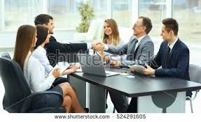 office meeting. Meeting Business Partners In A Modern Office