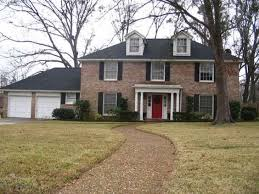 brick with black shutters and red door home ideas