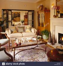 Townhouse Living Room Tea Set On Coffee Table In Front Of Fireplace In Townhouse Living