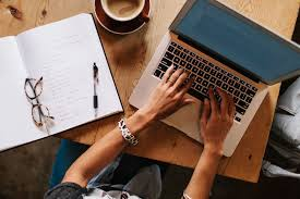 get paid to write essays for students professional writing service  getting paid to write essays and term papers lance writer typing on laptop