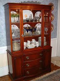 classyc dining room showcase ideas with brown varnished wooden materials also glass door