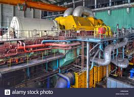 power plant generators. Machine Room In Thermal Power Plant With Electric Generators And Turbines
