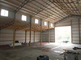 exposed steel beams residential using pole barn metal truss system how to build roof calculator structural