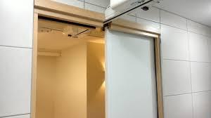 a hoist track running through a doorway header of a sliding door