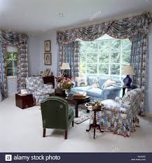 Patterned Curtains Living Room Patterned Blue Armchairs And Matching Curtains With Draped Pelmet