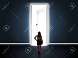 business woman looking at big bright opened door concept stock photo 42441353
