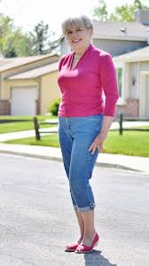 In jeans mature woman