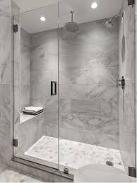 Transitional gray tile and white tile mosaic tile floor alcove shower photo  in New York with