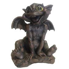 11 in baby brother ivan gargoyle with gold eyes siting up for