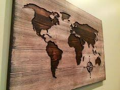 carved wooden world map wood wall art world map home decor world map decal world map poster distressed chic shabby housewarming on reclaimed wood world map wall art with diy world map wall art that is easy to make and unique crafty