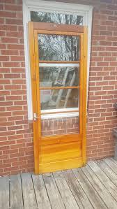 antique exterior wood screen door with