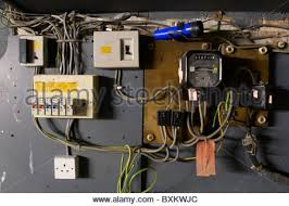 domestic home electrics main fuse box on off switch uk stock old electrical installation switch box meter and fuse box stock photo