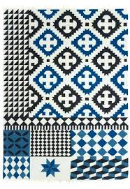 with distinct patterns in black blue and white wool kilim rug nate berkus