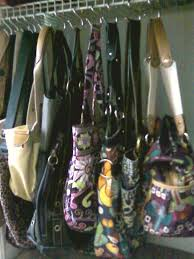 purse organization-hang purses on hooks--via roomandbath.com