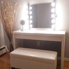 lighted mirror ikea. love the bench, wall mirror is kolja from ikea, lights are musik lighted ikea