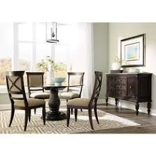 jessa dining room set with round dining table sideboard and 4 side chairs in dark brown