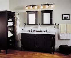bathroom with black furniture and traditional bar lights black bathroom lighting